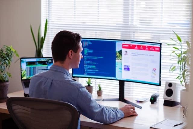 Man working looking at his screen_Marketing tools