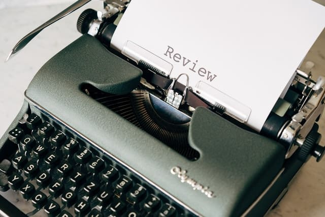 Typewriter with the word Review_Marketing content